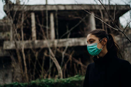 Sick woman wearing hygienic protective mask.Respiratory system infectious disease victim.Lethal lung disease.Attacked immune system.Viral fever.Desperate sick person
