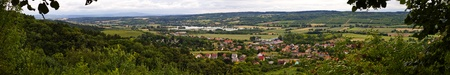 Rural panoramic view of a typical hungarian village  surrounded by fully green nature.