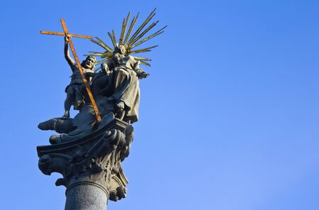 Statue of Christ carrying a cross, in the middle of Bratislava, Slovakia with a perfectly clear blue sky.