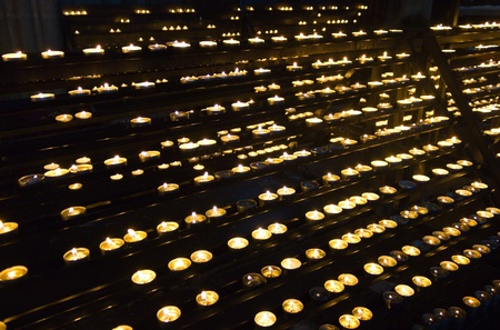 Rows of praying candles in Vienna's Cathedral. photo