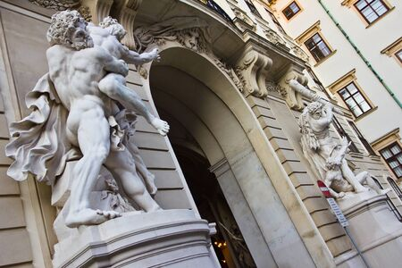 Hercules white stone statues in the southern entrance of Hofburg palace in Vienna, Austria. Part of the series known as The Labors of Hercules by Lorenzo Matielli.