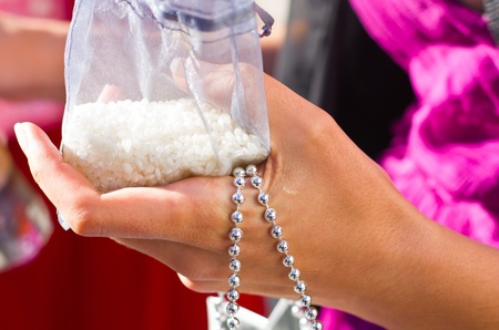 Sachet of white rice ready to throw away after a wedding ceremony.