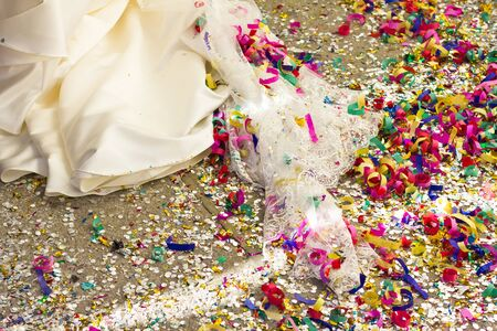 Floor full of rice, paper lace and confetti, after a wedding ceremony. photo