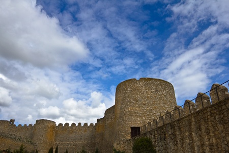 Castle wall of a small spanish village called Uruena, under a cloudy blue sky. Stock Photo - 11000488