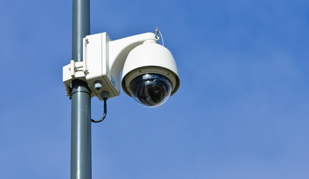 360 degrees surveillance camera on a pole, blue sky. Stock Photo - 11143489