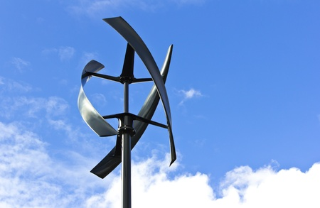 Silent urban styled wind turbine, blue sky.