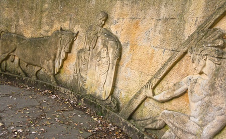 Fontibre, Spain, October 15, 2011 - Carved stone wall in Fontibre with a myth representation Stock Photo - 11555859