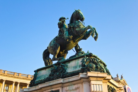 Vienna, Austria, July 22, 2011 - Low angle view of the statue of Prince Eugene of Savoy in front of Hofburg Palace, located in the Heroes Square