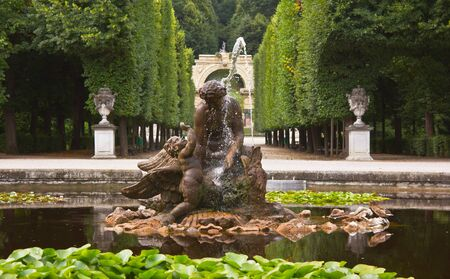 Vienna, Austria, July 23, 2011 - Naiad fountain in the round pool of the Schönbrunn Palace, as nymphs of springs and streams, naiads were followers of Neptune, and the statue represents a naiad playing with a waterbird Editorial