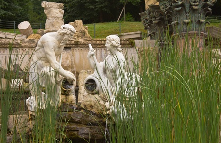 nbrunn: Vienna, Austria, July 23, 2011 - Sculpture of a man and woman in a river in the roman ruins in Sch�nbrunn Palace