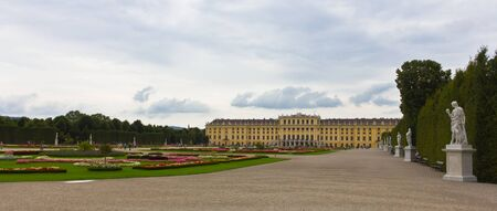 nbrunn: Vienna, Austria, July 23, 2011 - Panoramic view of the Sch�nbrunn Palace surrounded by beautiful gardens and sculptures Editorial
