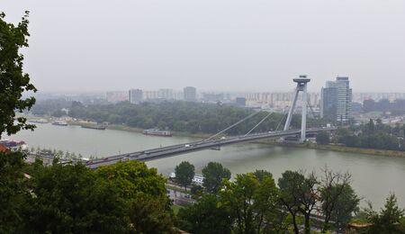 Bratislava, Slovakia, July 20, 2011 - Panoramic view of the Novy Most Bridge in Bratislava, Slovakia on a rainy and cloudy day Stock Photo - 11581016
