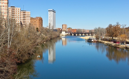 Pisuerga river in the middle of Valladolid with a perfecly blue water and sky. Stock Photo