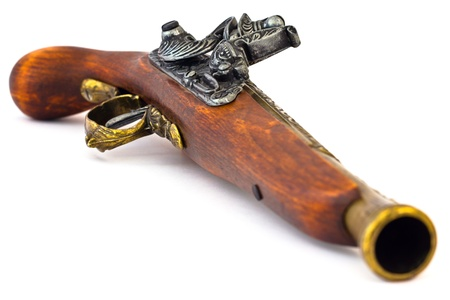 blunderbuss: Old wooden gun, upper side, selective focus, on white background.