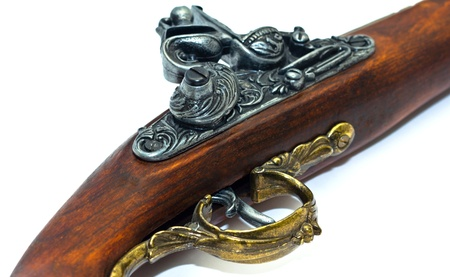 flintlock: Antique flintlock blunderbuss pistol detail, on white background.