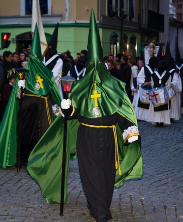 VALLADOLID, SPAIN � APRIL 6, 2012: Black and green Nazarenos participants in the religious processions during Holy Week on Good Friday, on April 6, 2012 in Valladolid, Spain.