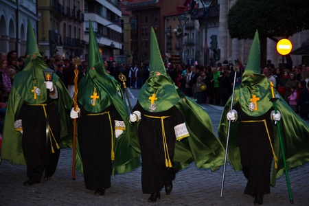 VALLADOLID, SPAIN � APRIL 6, 2012: Black and Green Nazarenos participants in the religious processions during Holy Week on Good Friday, on April 6, 2012 in Valladolid, Spain. Stock Photo - 13062798