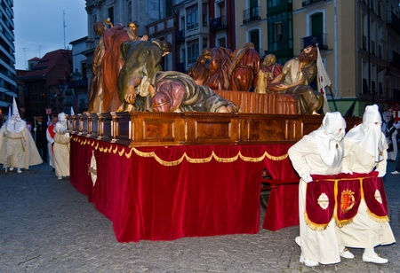 VALLADOLID, SPAIN � APRIL 6, 2012: White Nazarenos carrying a Christ figure in the religious processions during Holy Week on Good Friday, on April 6, 2012 in Valladolid, Spain.