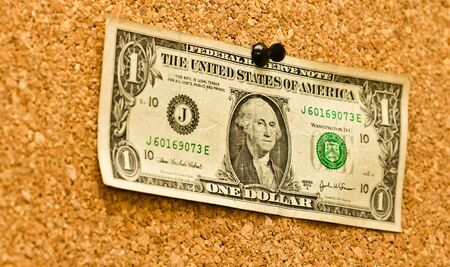 Dollar bill on a noticeboard, selective focus. photo