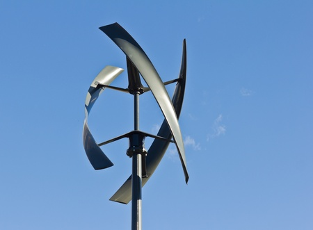 Silent urban styled wind turbine with blue sky. photo
