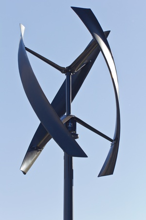 City styled wind turbine, blue sky. photo