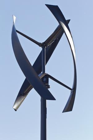 City styled wind turbine, blue sky. Stock Photo - 13734022