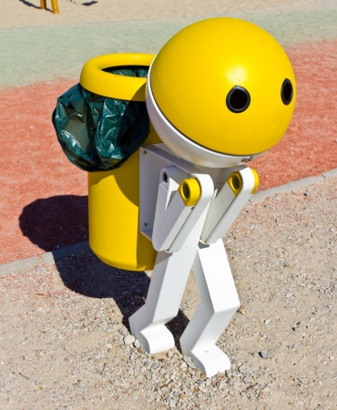 garbage can: Garbage can with the shape of a robot yellow and white.