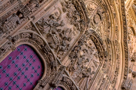 Salamanca Cathedral main door with an extremely carved wall. Stock Photo