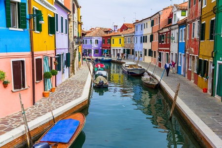 venice canal: Burano canal full of boats and colorful houses.