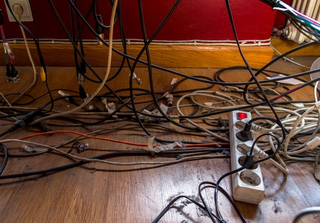 Cables and sockets full of dust and dirt in the floor of an old office. Stock Photo