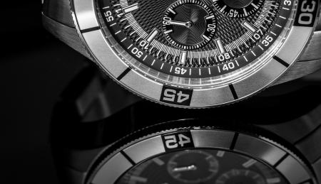 Luxury Watch over reflective surface  Selective focus, shallow depth of field