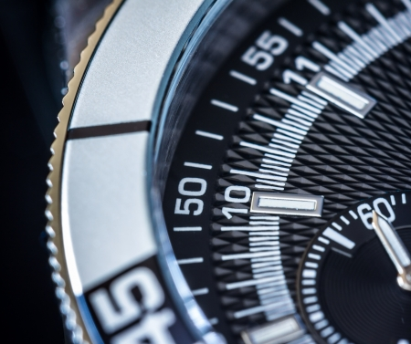 chronograph: Close up of a steel chronograph. Selective focus, shallow depth of field. Stock Photo