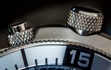 Detail of a chonograph buttons. Selective focus, shallow depth of field. photo