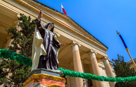 Nun statue in front of malta law courts in the republic street in Valletta  photo