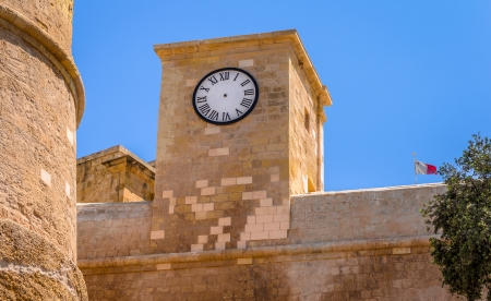 Clock situated in the walls of the citadel in Gozo, Malta