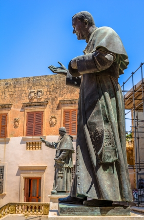 ix: Sculptures of Pope John Paul II and Pius IX at the entrance of the Gozo Cathedral in Malta