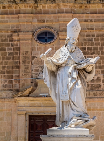 Saint Augustine statue in front of the St Augustine convent in Victoria, Gozo, Malta