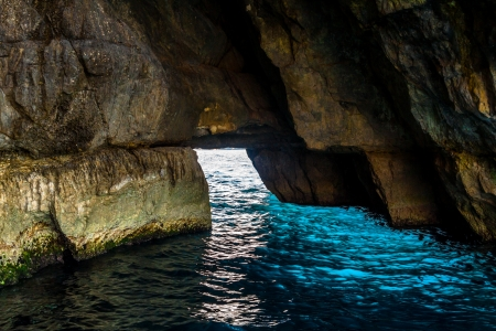 Turquoise water inside one of the Blue Grotto caverns in Malta
