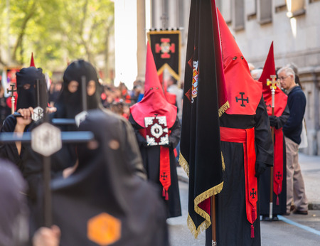 holy thursday: VALLADOLID, SPAIN � APRIL 17, 2014  Red and black nazarenos in the religious processions during Holy Week on Good Thursday, on April 17, 2014 in Valladolid, Spain