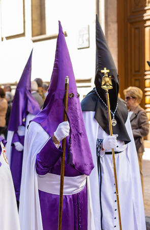 holy thursday: VALLADOLID, SPAIN – APRIL 17, 2014  Typical purple nazarenos in the religious processions during Holy Week on Good Thursday, on April 17, 2014 in Valladolid, Spain