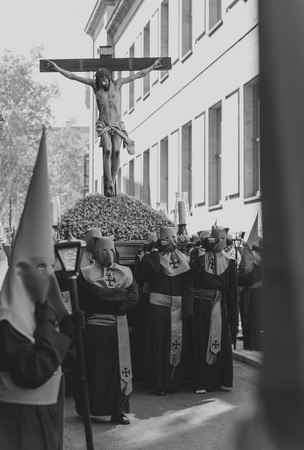 holy thursday: VALLADOLID, SPAIN � APRIL 17, 2014  Black and white picture of the religious processions during Holy Week on Good Thursday, on April 17, 2014 in Valladolid, Spain