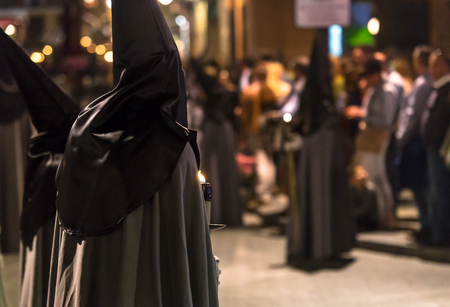 holy thursday: VALLADOLID, SPAIN � APRIL 17, 2014  Nazarenos with candles in the religious processions during Holy Week on Good Thursday Night, on April 17, 2014 in Valladolid, Spain  Editorial
