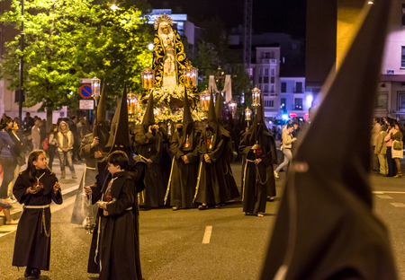 holy thursday: VALLADOLID, SPAIN � APRIL 17, 2014  Nazarenos carrying Virgin sculpture in the religious processions during Holy Week on Good Thursday Night, on April 17, 2014 in Valladolid, Spain
