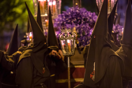 holy thursday: VALLADOLID, SPAIN � APRIL 17, 2014  Nazarenos carrying sculpture in the religious processions during Holy Week on Good Thursday Night, on April 17, 2014 in Valladolid, Spain