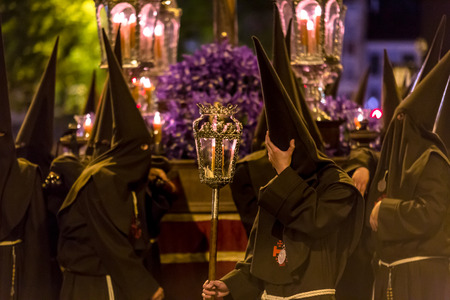 holy thursday: VALLADOLID, SPAIN � APRIL 17, 2014  Black nazarenos in the religious processions during Holy Week on Good Thursday Night, on April 17, 2014 in Valladolid, Spain