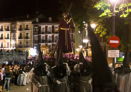 holy thursday: VALLADOLID, SPAIN � APRIL 17, 2014  Nazarenos carrying a Jesuschrist sculpture in the religious processions during Holy Week on Good Thursday Night, on April 17, 2014 in Valladolid, Spain  Editorial