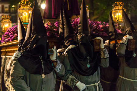 holy thursday: VALLADOLID, SPAIN � APRIL 17, 2014  Nazarenos carrying a sculpture in the religious processions during Holy Week on Good Thursday Night, on April 17, 2014 in Valladolid, Spain