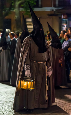 holy thursday: VALLADOLID, SPAIN � APRIL 17, 2014  Nazareno with a lamp in the religious processions during Holy Week on Good Thursday Night, on April 17, 2014 in Valladolid, Spain  Editorial