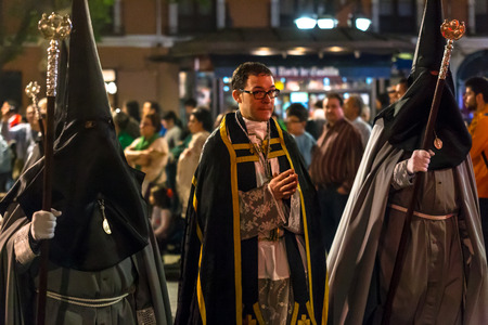 crucis: VALLADOLID, SPAIN – APRIL 17, 2014  People in the religious processions during Holy Week on Good Thursday Night, on April 17, 2014 in Valladolid, Spain  Editorial