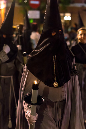 holy thursday: VALLADOLID, SPAIN � APRIL 17, 2014  Nazareno carrying a candle in the religious processions during Holy Week on Good Thursday Night, on April 17, 2014 in Valladolid, Spain
